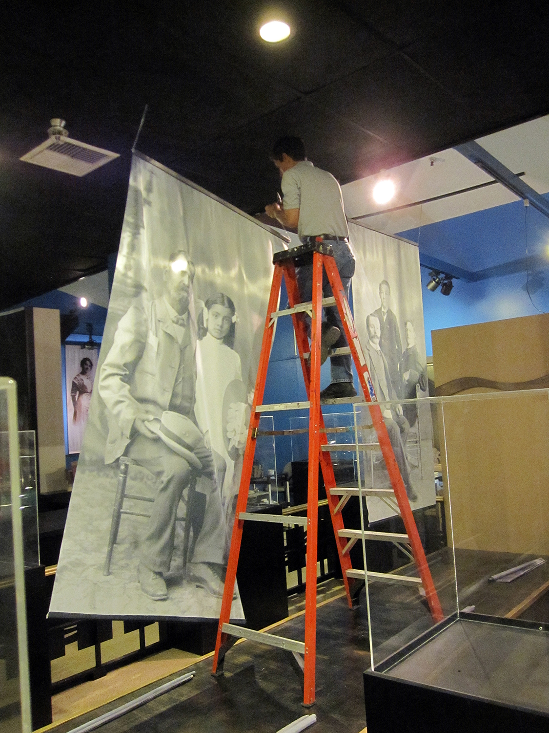 "Craig Putnam, the county museum's exhibit fabrication specialist, in the process of mounting the museum's newest special exhibit, ""Portraits and Views: The Redlands Photographic Studio 1897—1924."" The exhibit opens to the public on Saturday, November 9."