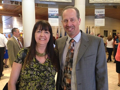 Registrar of Voters employee Christina Anderson and Registrar Michael Scarpello attend reception for employees