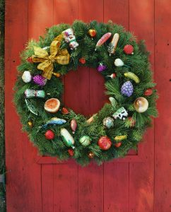 ca. 2006 --- Christmas Wreath on Red Door --- Image by © Royalty-Free/Corbis