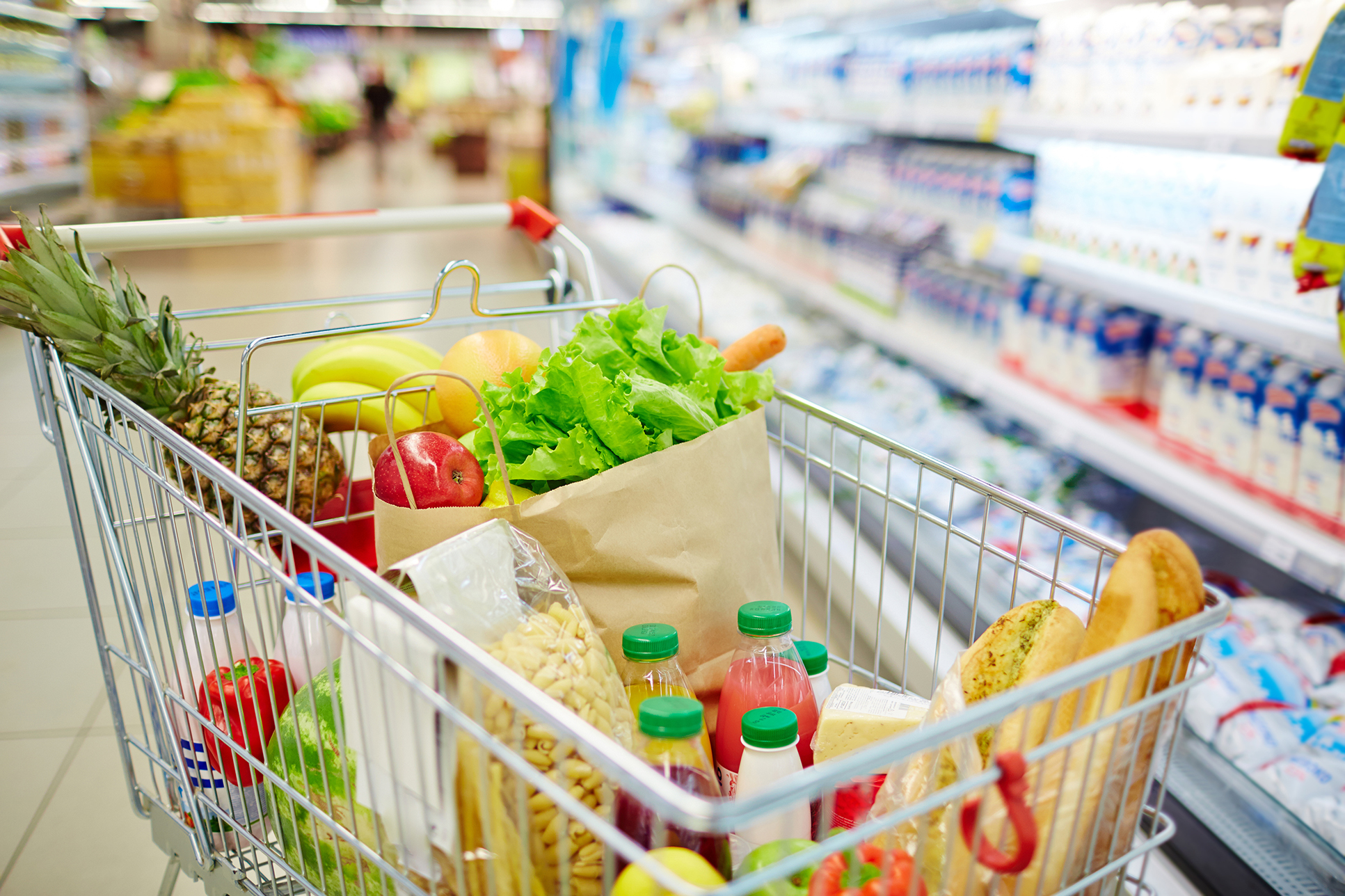 Different foods in a shopping cart