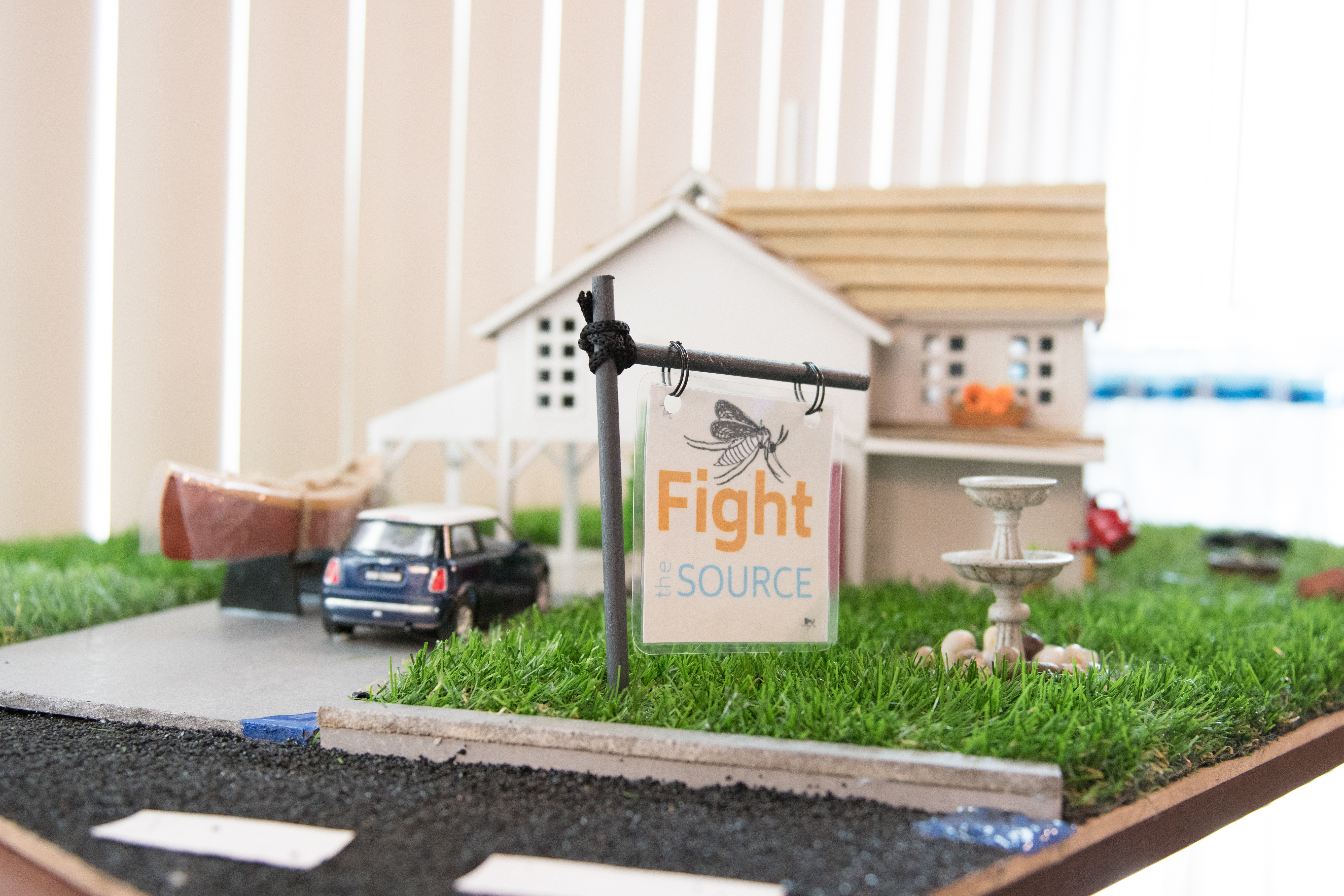 """""""Fight the Source"""" model that is used at multiple events to illustrate mosquito breeding sites that can be found around homes."""