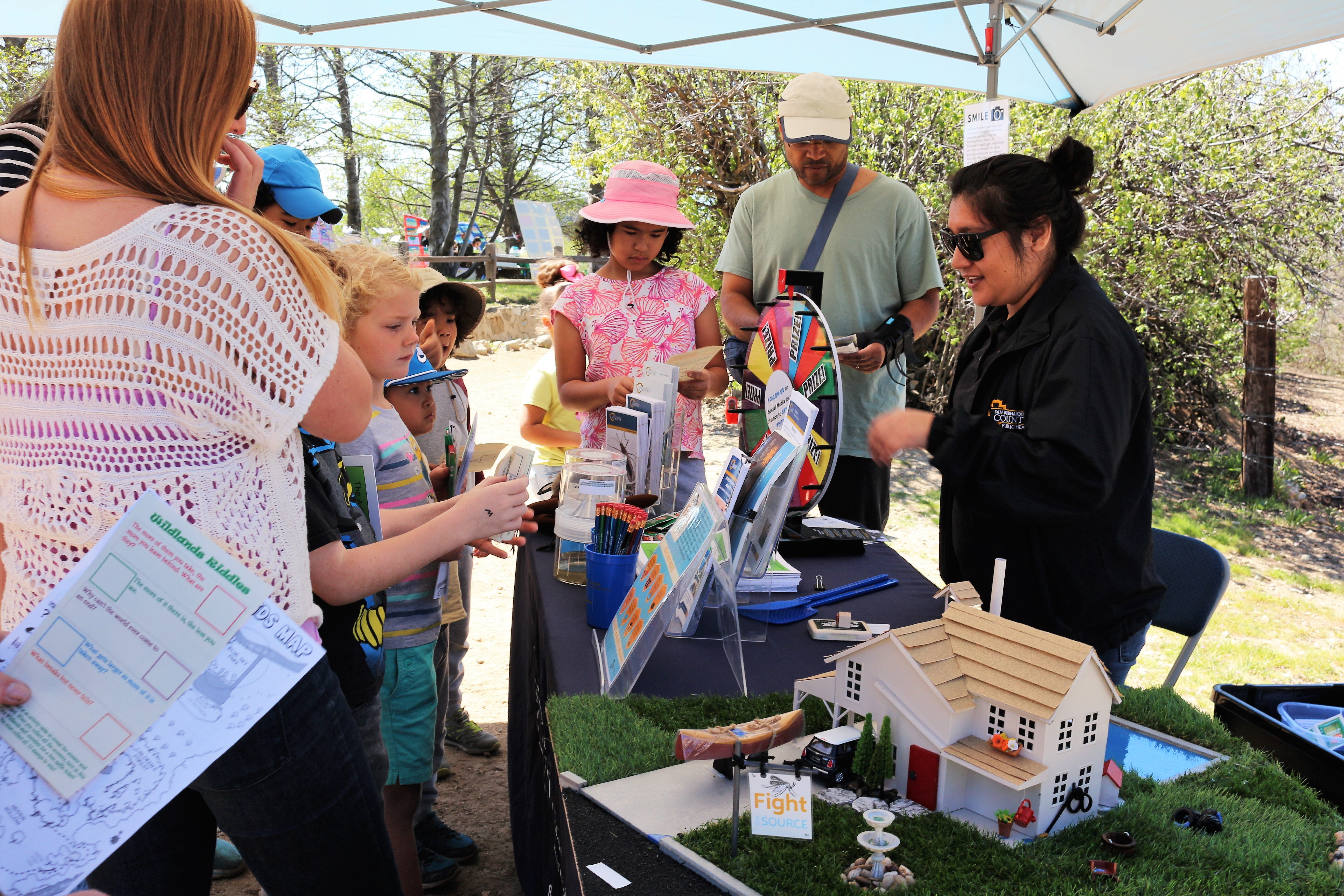 Health Education Specialist talking to the public about vector safety at the Arts and Nature Festival in Oak Glen.