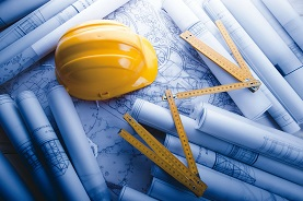 construction hardhat with plans